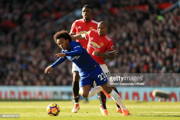 Ashley Young of Man Utd battles with Willian of Chelsea during the Premier League match between Manchester United and Chelsea at Old Trafford on...