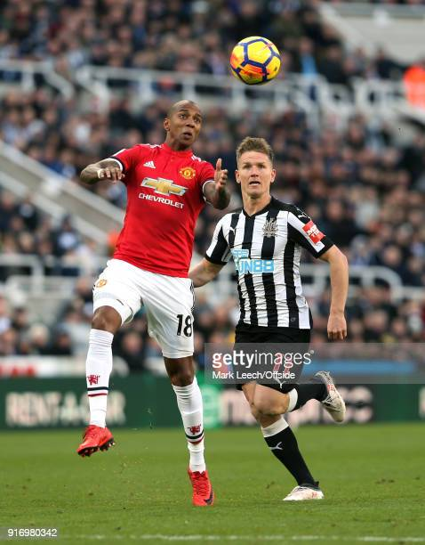 Ashley Young of Man Utd heads the ball watched by Matt Ritchie of Newcastle during the Premier League match between Newcastle United and Manchester...