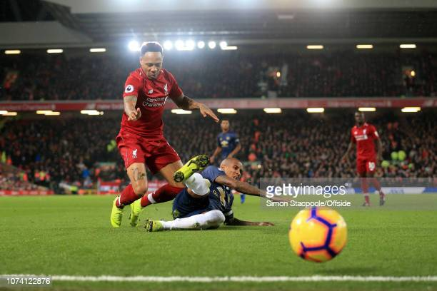 Ashley Young of Man Utd tackles Nathaniel Clyne of Liverpool during the Premier League match between Liverpool and Manchester United at Anfield on...