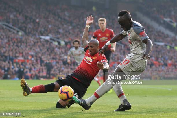 Ashley Young of Man Utd tackles Sadio Mane of Liverpool during the Premier League match between Manchester United and Liverpool at Old Trafford on...