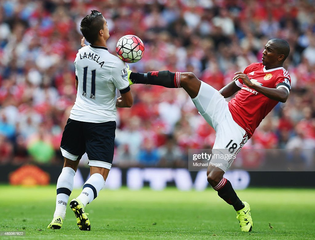 Ashley Young of Manchester United and Erik Lamela of Tottenham Hotspu compete for the ball during the Barclays Premier League match between Manchester United and Tottenham Hotspur at Old Trafford on August 8, 2015 in Manchester, England.