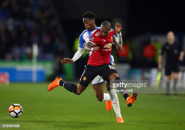 Ashley Young of Manchester United and Terence Kongolo of Huddersfield Town in action during the The Emirates FA Cup Fifth Round between Huddersfield...