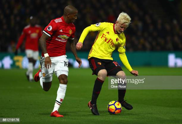 Ashley Young of Manchester United and Will Hughes of Watford in action during the Premier League match between Watford and Manchester United at...