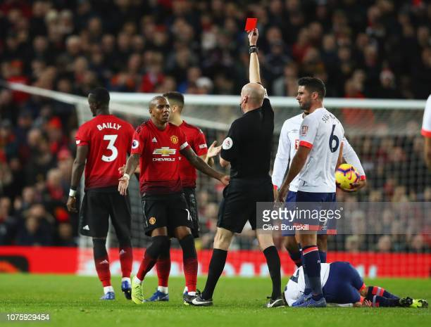 Ashley Young of Manchester United appeals as Eric Bailly of Manchester United is shown a red card and is sent off by referee Lee Mason during the...