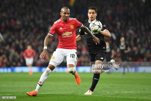 Ashley Young of Manchester United battles Wissam Ben Yedder of Seville during the UEFA Champions League Round of 16 Second Leg match between...