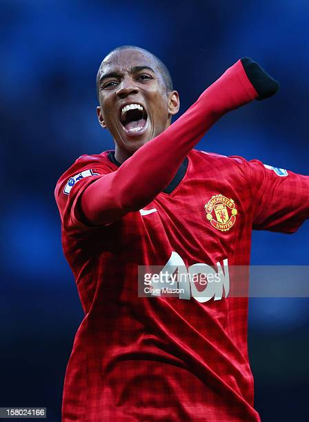 Ashley Young of Manchester United celebrates at the end of the Barclays Premier League match between Manchester City and Manchester United at the...