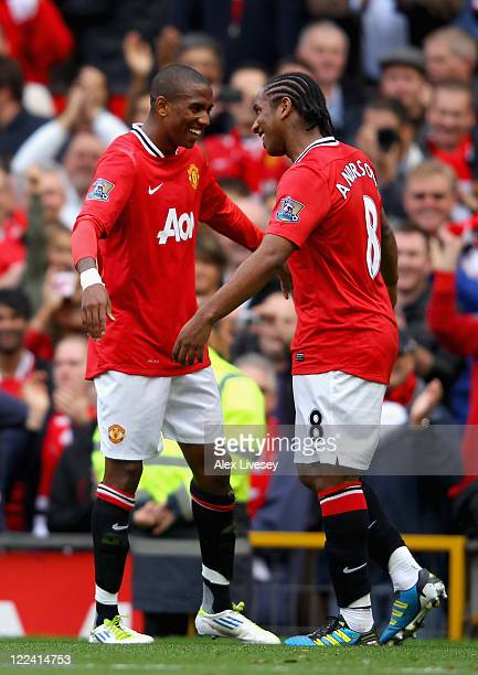 Ashley Young of Manchester United celebrates scoring his side's second goal with team mate Anderson during the Barclays Premier League match between...