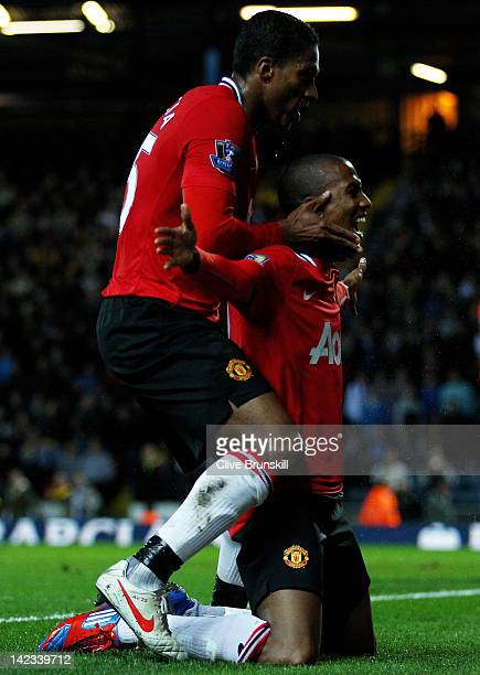 Ashley Young of Manchester United celebrates scoring his team's second goal with team mate Antonio Valencia during the Barclays Premier League match...