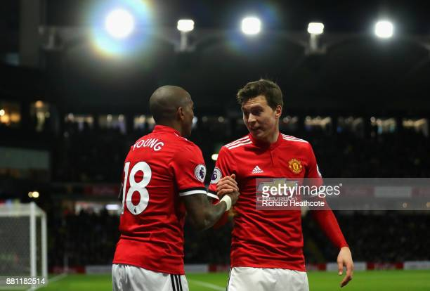 Ashley Young of Manchester United celebrates scoring the first goal with Victor Lindelof of Manchester United during the Premier League match between...