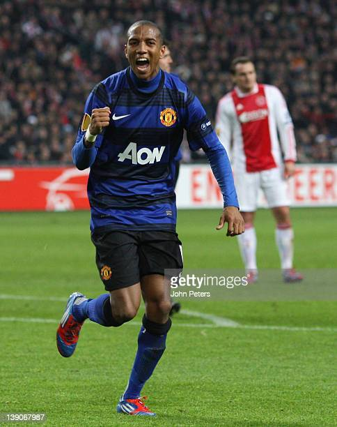 Ashley Young of Manchester United celebrates scoring their first goal during the UEFA Europa League round of 32 first leg match between AFC Ajax and...