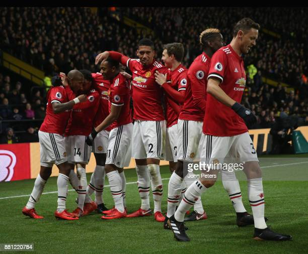 Ashley Young of Manchester United celebrates scoring their second goal during the Premier League match between Watford and Manchester United at...
