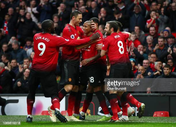 Ashley Young of Manchester United celebrates with teammates after scoring his team's first goal during the Premier League match between Manchester...