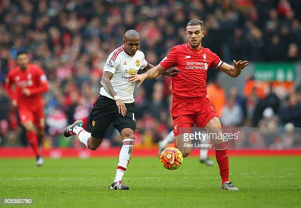 Ashley Young of Manchester United challenges for the ball with Jordan Henderson of Liverpool during the Barclays Premier League match between...