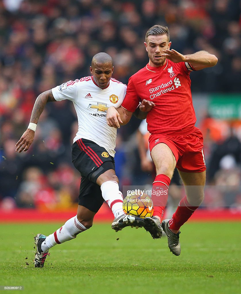 Ashley Young of Manchester United challenges for the ball with Jordan Henderson of Liverpool during the Barclays Premier League match between Liverpool and Manchester United at Anfield on January 17, 2016 in Liverpool, England.
