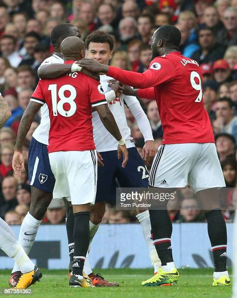 Ashley Young of Manchester United clashes with Dele Alli of Tottenham Hotspur during the Premier League match between Manchester United and Tottenham...