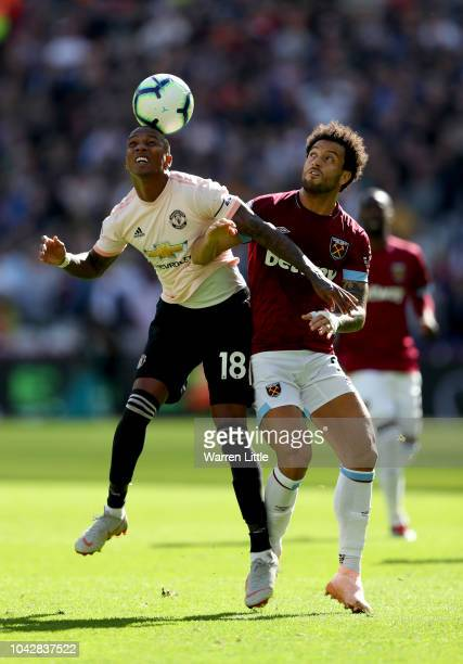 Ashley Young of Manchester United competes for tha ball with Felipe Anderson of West Ham United during the Premier League match between West Ham...