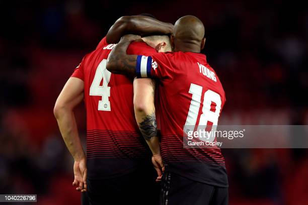 Ashley Young of Manchester United consoles teammate Phil Jones of Manchester United after he misses his teams eight penalty resulting in Derby County...
