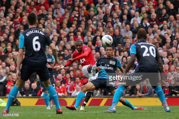 Ashley Young of Manchester United curls the ball and scores his side's second goal during the Barclays Premier League match between Manchester United...