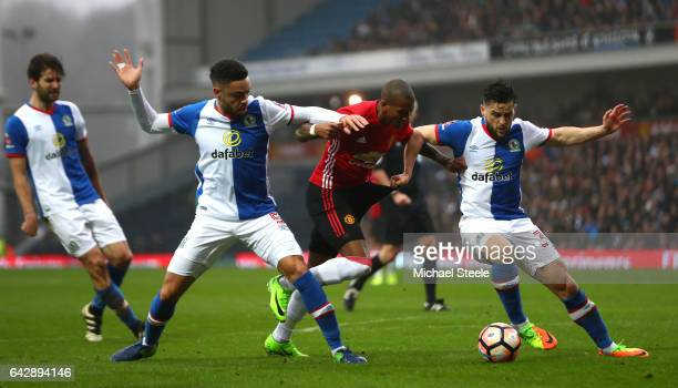 Ashley Young of Manchester United goes between Derrick Williams and Craig Conway of Blackburn Rovers during The Emirates FA Cup Fifth Round match...