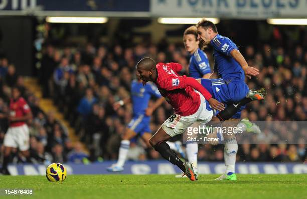 Ashley Young of Manchester United goes to ground leading to the sending off of Branislav Ivanovic of Chelsea during the Barclays Premier League match...