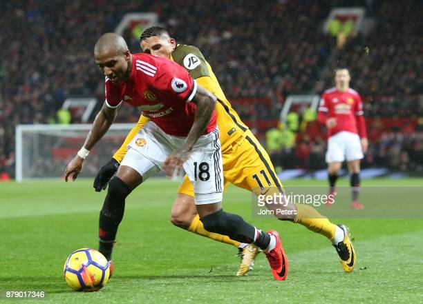 Ashley Young of Manchester United in action with Anthony Knockaert of Brighton and Hove Albion during the Premier League match between Manchester...