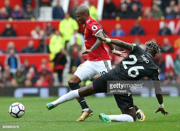 Ashley Young of Manchester United in action with Bakary Sako of Crystal Palace during the Premier League match between Manchester United and Crystal...