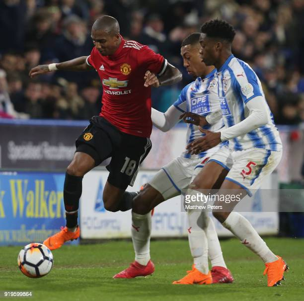 Ashley Young of Manchester United in action with Terence Kongolo of Huddersfield Town during the Emirates FA Cup Fifth Round match between...