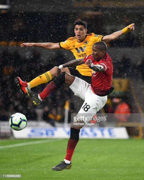 Ashley Young of Manchester United is challenged by Raul Jimenez of Wolverhampton Wanderers during the Premier League match between Wolverhampton...