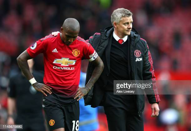 Ashley Young of Manchester United is consoled by Ole Gunnar Solskjaer Manager of Manchester United after the Premier League match between Manchester...