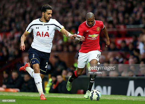 Ashley Young of Manchester United is pursued by Nacer Chadli of Spurs during the Barclays Premier League match between Manchester United and...