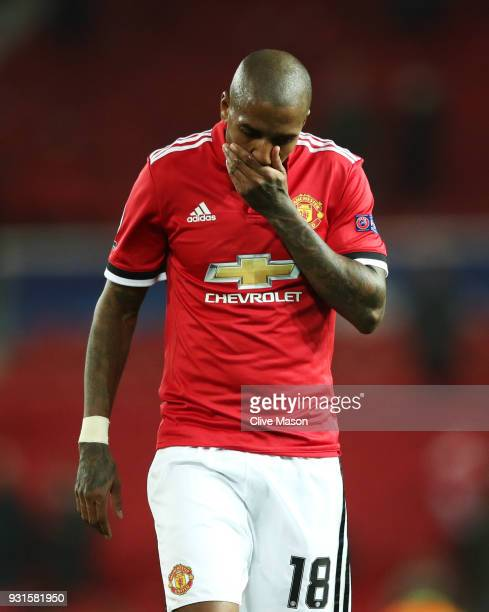 Ashley Young of Manchester United looks dejected in defeat after the UEFA Champions League Round of 16 Second Leg match between Manchester United and...