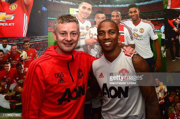 Ashley Young of Manchester United poses with Caretaker Manager Ole Gunnar Solskjaer after singing a new contract extension at Aon Training Complex on...