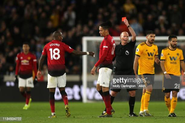 Ashley Young of Manchester United receives a second yellow card resulting in a sending off during the Premier League match between Wolverhampton...