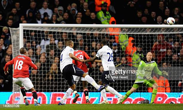 Ashley Young of Manchester United shoots and scores his side's third goal past Brad Friedel of Tottenham Hotspur during the Barclays Premier League...