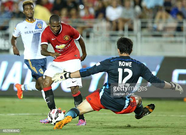 Ashley Young of Manchester United shoots but is blocked by goal keeper Brian Rowe of the Los Angeles Galaxy at the Rose Bowl on July 23 2014 in...