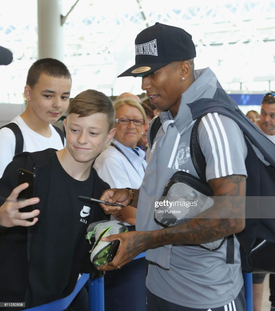 Ashley Young of Manchester United signs autographs at Manchester Airport ahead of the club's pre-season tour of the USA at Manchester Airport on July 9, 2017 in Manchester, England.