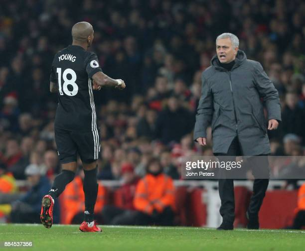 Ashley Young of Manchester United tells Manager Jose Mourinho that Paul Pogba is about to be sent off during the Premier League match between Arsenal...