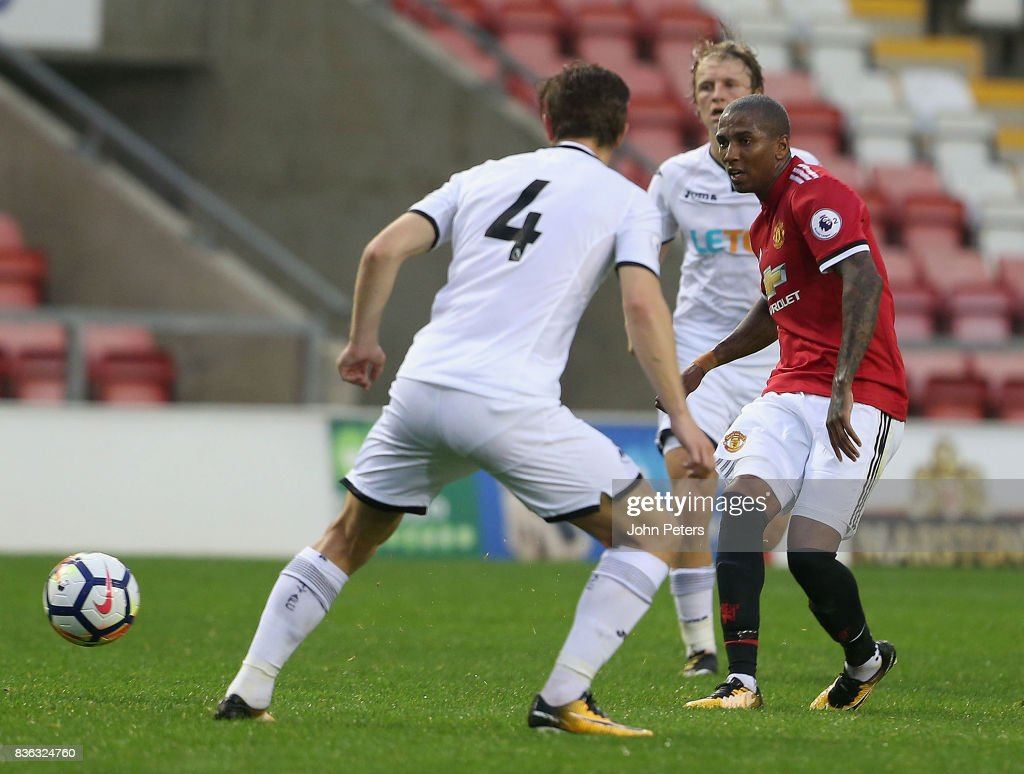Ashley Young of Manchester United U23s in action with Adnan Maric of Swansea City during the Premier League 2 match between Manchester United U23s and Swansea City U23s at Leigh Sports Village on August 21, 2017 in Leigh, Greater Manchester.