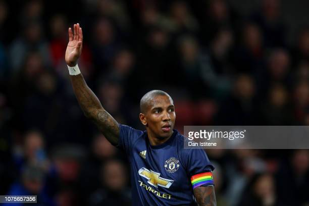 Ashley Young of Manchester United wearing a rainbow coloured captain's armband signals to his teammates during the Premier League match between...