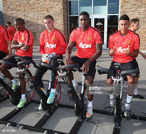 Ashley Young Sam Johnstone Tyler Blackett and Jesse Lingard of Manchester United in action during a first team training session as part of their...