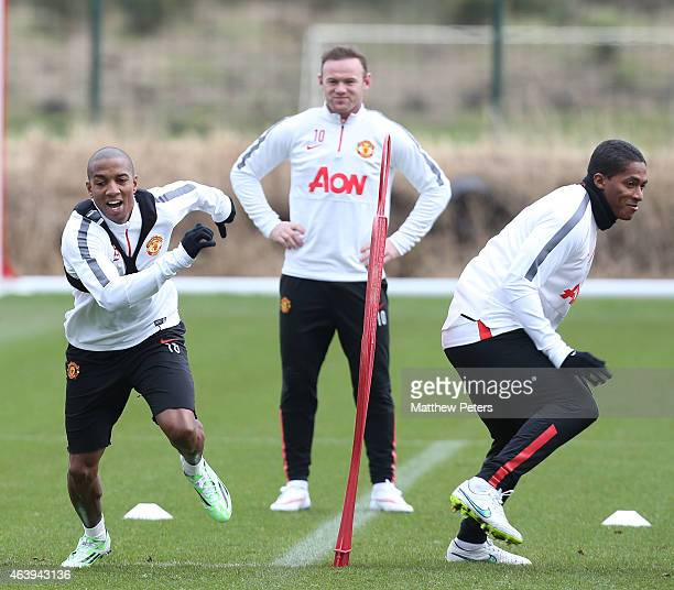 Ashley Young Wayne Rooney and Antonio Valencia of Manchester United in action during a first team training session at Aon Training Complex on...