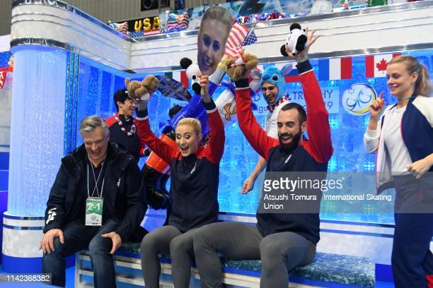 AshleyCain and TimothyLeduc of the United States celebrate their score at the kiss and cry with their team mates after competing in the Pair Free...