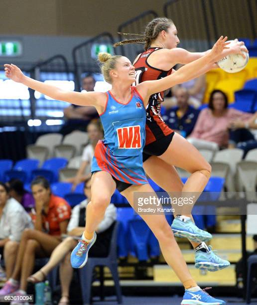 Ashlie Unie of the Storm and Georgia Marshall of the Waratahs compete for the ball during the round seven Australian Netball League match between the...