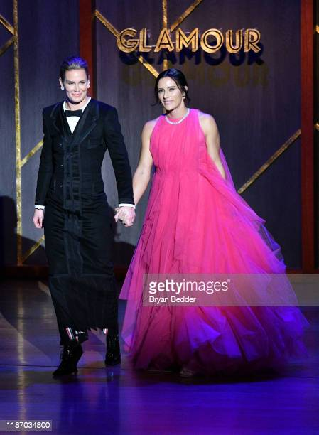 Ashlyn Harris and Ali Krieger walk onstage at the 2019 Glamour Women Of The Year Awards at Alice Tully Hall on November 11 2019 in New York City