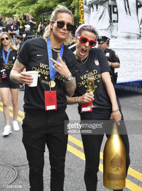 Ashlyn Harris and Megan Rapinoe pose as members of the World Cup-winning US women's team take part in a ticker tape parade for the women's World Cup...
