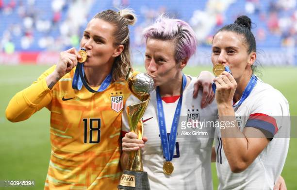 Ashlyn Harris Megan Rapinoe and Ali Krieger of the USA celebrate with the FIFA Women's World Cup Trophy following the 2019 FIFA Women's World Cup...