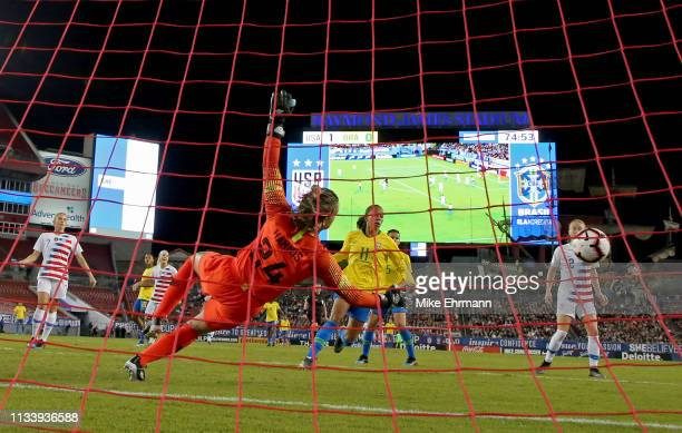 Ashlyn Harris of the USA stops a shot from Adriana of Brazilduring the She Believes Cup at Raymond James Stadium on March 05 2019 in Tampa Florida