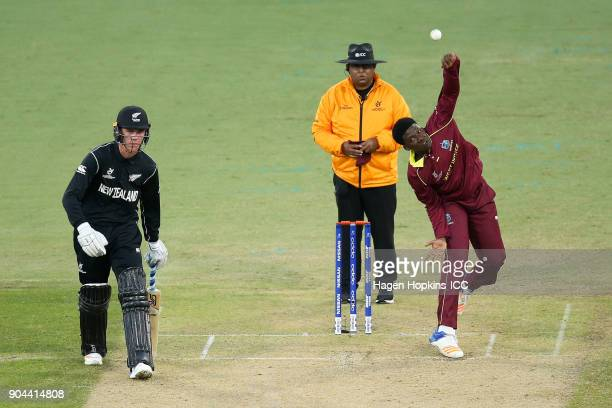Ashmead Nedd of the West Indies bowls while Finn Allen of New Zealand looks on during the ICC U19 Cricket World Cup match between New Zealand and the...