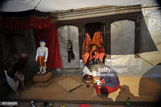 JAN BAHAL KATHMANDU NEPAL KATHMANDU NE NEPAL Ashok Muni Bajracharya 55yrs old a priest decorates the idol Seto Machhendranath at Jan Bahal Seto...