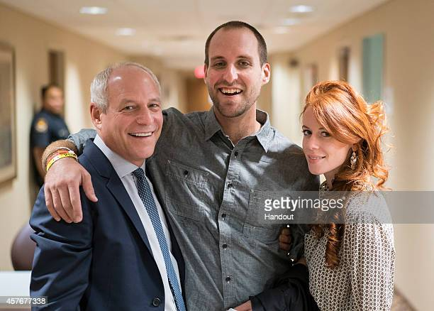 Ashoka Mukpo and his girlfriend Helen Finlay say farewell to Dr Mitchell Levy after being released from the treatment unit at the Nebraska Medical...